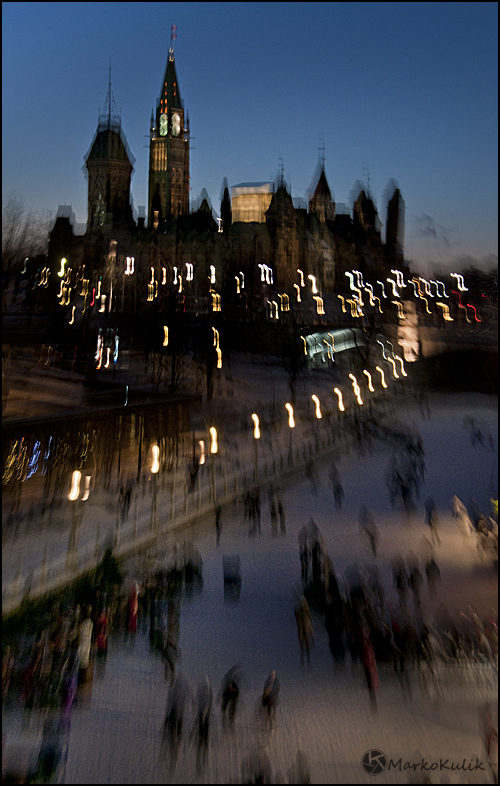 This is the Rideau Canal in Ottawa, Canada with the parliament buildings in the background